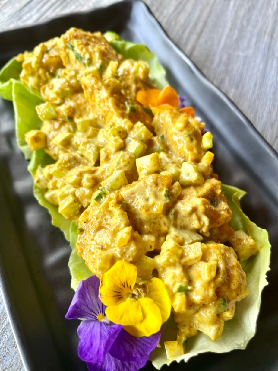 A photo of a yellow curry chicken salad platter.