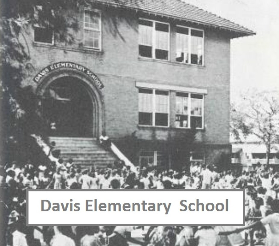 """An old black and white photo of the exterior of a brick building with a caption that reads """"Davis Elementary School"""""""