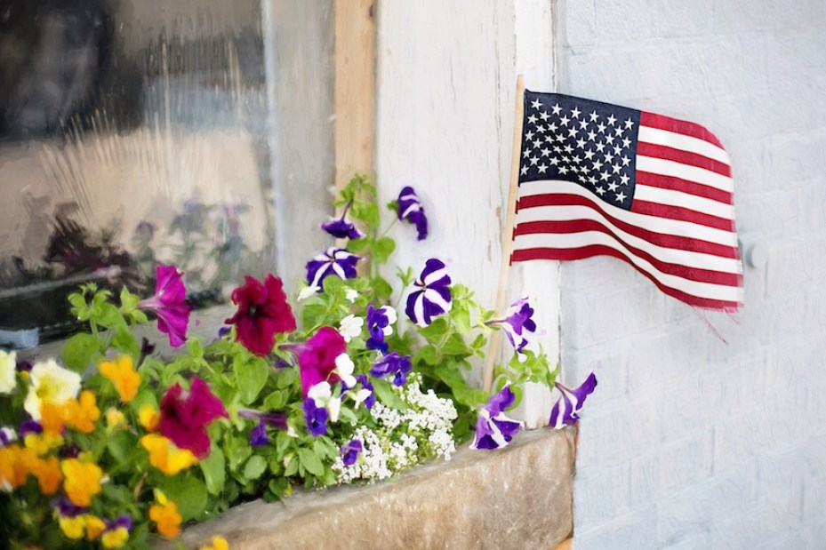 A flower winds box with a small US flag stuck in it.