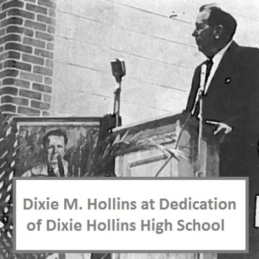"""An old black and white photo of a man at a podium standing next to portrait with a caption that reads """"Dixie M. Hollins at Dedication of Dixie Hollins High School"""""""