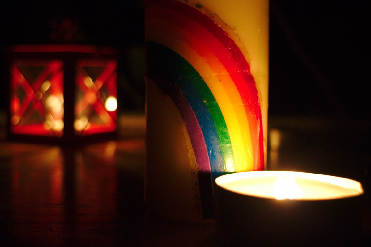 Rainbow candle in a dark room