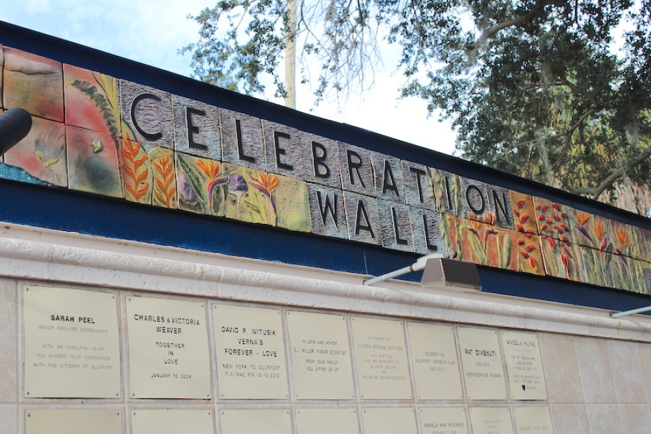 """A photo of a a wall with a colorful top that reads """"Celebration Wall"""""""