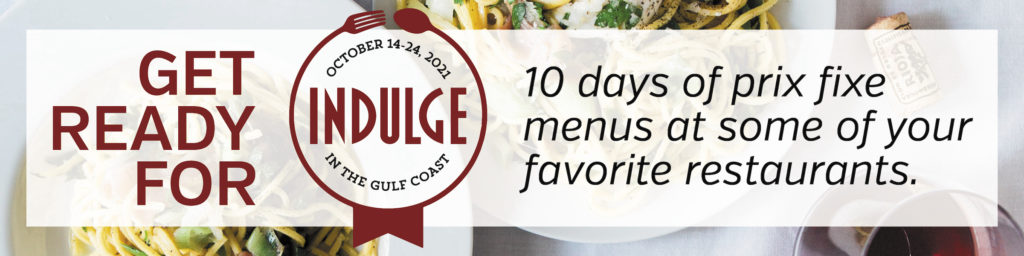 """A logo in red and white over a photo of food featuring the word """"Indulge"""" in large red print with the words """"October 14-24, 2021"""" in a semi-circle above it and the words """"In the Gulf Coast"""" in a semi circle below it. The words """"10 days of prix fixe menus at some of your favorite restaurants."""" to the right of the logo."""