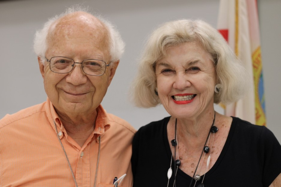 A photo of an older man and woman smiling at the camera.