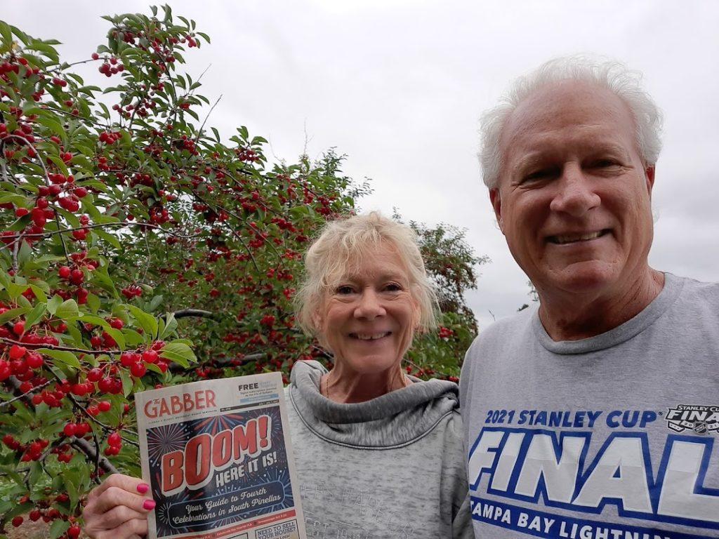 A photo of a man and a woman holding up a Gabber Newspaper