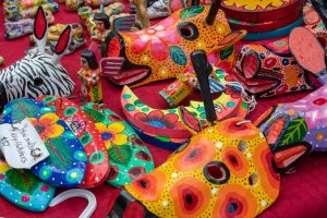 A close-up photo of a table of handmade colorful art pieces.