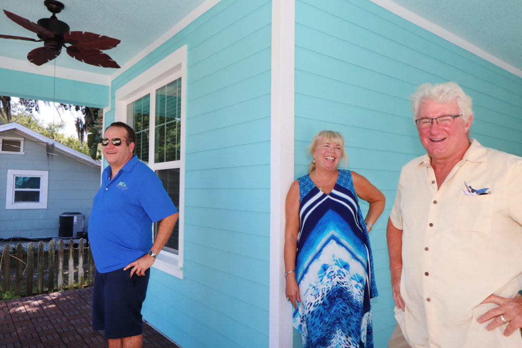 Owners of their new WinWay home at 2521 York St. in Gulfport Bill and Heidi Oetting with Matt Carr.