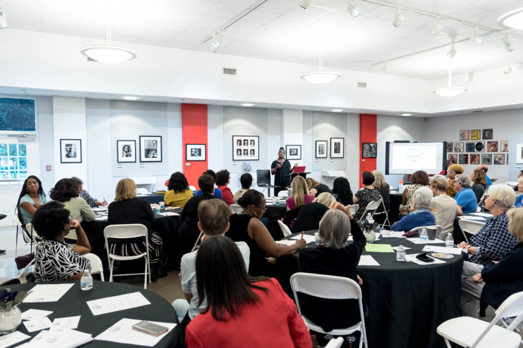 Women engage during the first Coffee in Common event at the Dr. Carter G. Woodson Museum, October 2019.