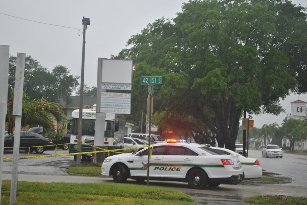Police investigate the shooting near Central on Wednesday morning.