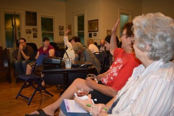 Carole Gabrio of Gulfport takes notes while Cathy Paunov of St. Petersburg, a member of the Church of Jesus Christ of Latter-day Saints, also known as Mormons, addresses members of the Gulfport Historical Society on Friday, April 15.