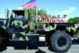 Girl Scout Troop 1505 aboard a U.S. Marine Corps military truck.