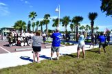 """Members of the combined bands of St. Andrew's Pipes and Drums of Tampa Bay and the Egypt Shriners Highlanders Pipes and Drums Unit pose for photographs at the newly renovated parking area along Shore Boulevard. The bands, which marched in Gulfport for the first time, came at the invitation of members of the Royal Canadian Legion, Post 144, Pinellas County, several of whom live in Gulfport. Drummer Bob Barrie said he enjoys the city. """"My wife drags me down here all the time."""""""
