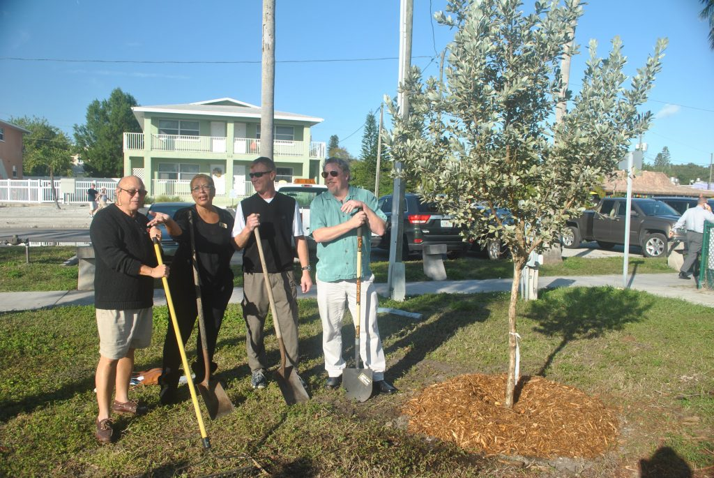 Members of Gulfport City Council planting a tree at an Arbor Day celebration.