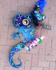 Denise Keegan worked in painting before relocating to Gulfport a few years ago. Inspired by her new home town's eccentricity, she has broadened her focus to include mixed media art that incorporates found and recycled objects. Her 2015 Gecko is on display at the Beach Bazaar.