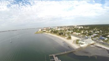 """The photos, provided by Gulfport City Councilmember Dan Liedtke, Ward 1, show Gulfport Beach as it is now and what it would look like if the council's plans to expand it come to fruition. The light areas in the water are """"muck,"""" which cannot be reused on the beach, Liedtke said."""