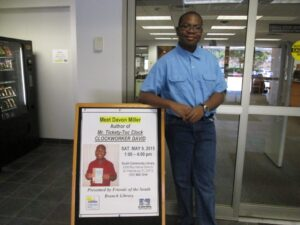Author Davon Miller, age 13, at the book signing for his children's series Mr. Tickety-Toc Clock at the South Branch Library in St. Petersburg on May 9.