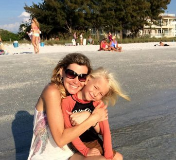 Julie Featherston and her son Harper on Sunset Beach.