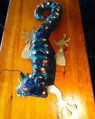 Matt Worsham creates textile-based mixed media, folk-art inspired sculptures depicting whimsical animals, mythological or fantasy-based creatures and more. His 2015 Gecko is on display at Little Tommie's Tiki.