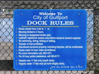 A sign at the docks behind the Gulfport Casino outlines the dock rules included in Ordinance 2015-08, passed December 1 to try to minimize nuisance behavior.