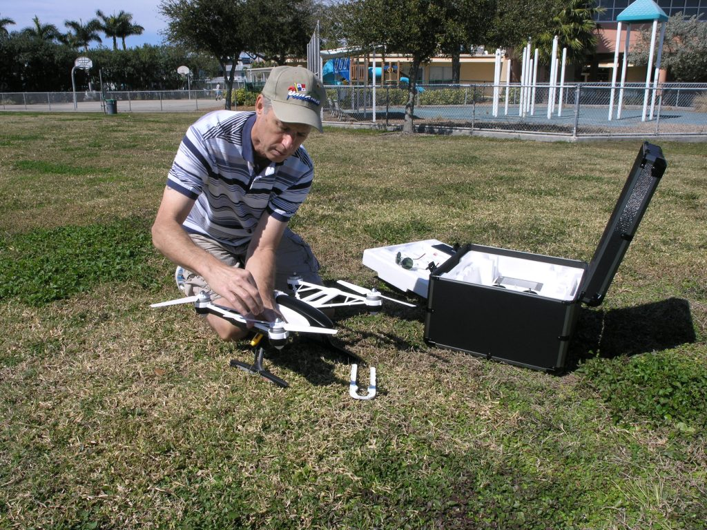 Philip Penrose of Gulfport demonstrates his drone, a Typhoon Yuneec Q500+CG02+Camera, at the green behind the Gulfport Recreation Center on Monday, February 22.