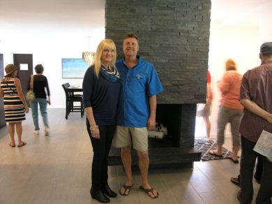 Lynn and Denis Frain stand in front of the slate fireplace they designed for the house they renovated at 4714 29th Ave. S., one of ten homes on view Saturday, March 5 for Gulfport's 11th annual Pink Flamingo Tour of Homes.