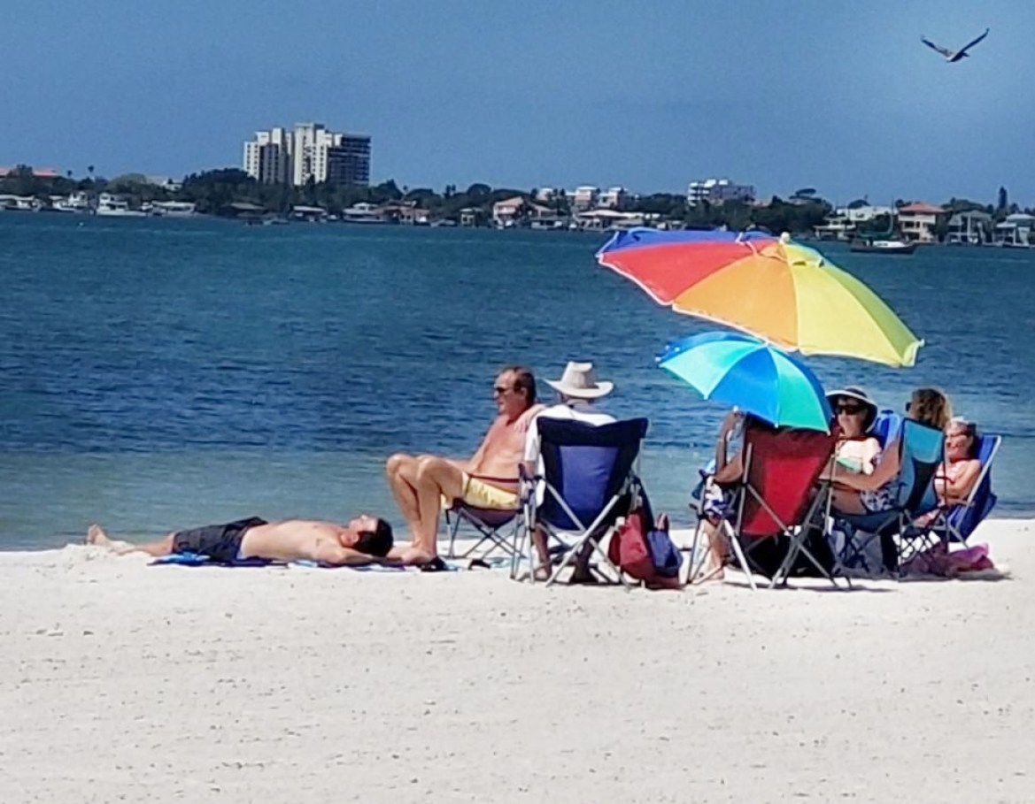 A group of people enjoying Gulfport Beach on Monday, May 4. Photo by June Johns