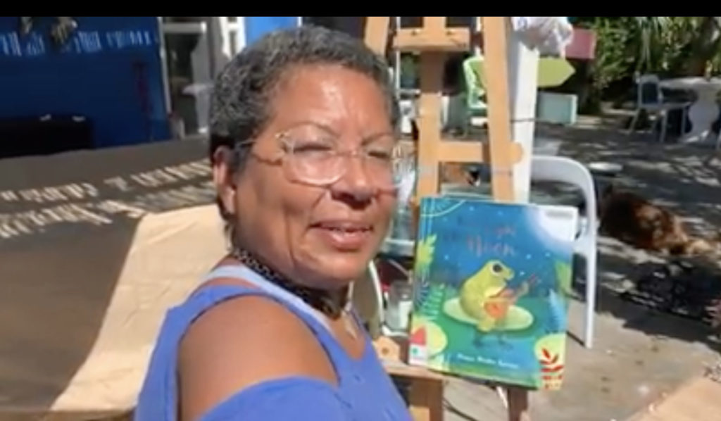 "Former Gulfport Councilmember Yolanda Roman shares the children's book ""By the Light of the Moon"" during ""Miss Yolanda's Reading Room"" on Facebook to share live readings of stories with children. Screencap courtesy of Yolanda Roman."