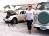 """Lauren Hallahan of Clearwater poses with the Volkswagen 1969 Beetle and the 1978 TinTop Weekender camper she owns with her husband Thom. """"I like the technology [of VWs] because they're air cooled,"""" she said. The Hallahans use their camper several times a year. Showing a reporter the various features of the vehicle, she said, """"They don't make stuff like that anymore."""""""