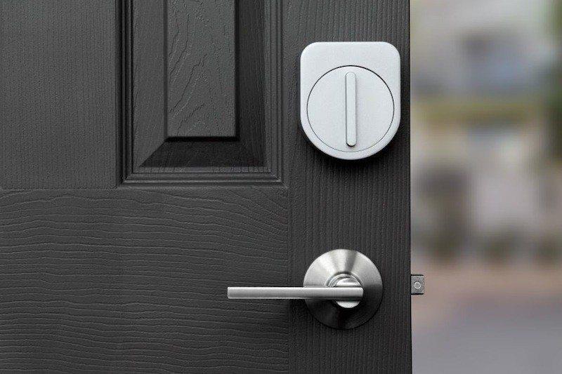 Sesame door lock on black door