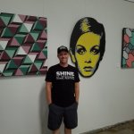 CHIZZY (Chad Mize) in front of his work