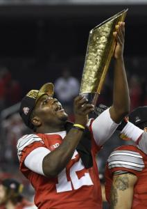 Cardale Jones holds the first ever College Football Playoff Trophy after Ohio State's 42-20 win over Oregon. (UPI)