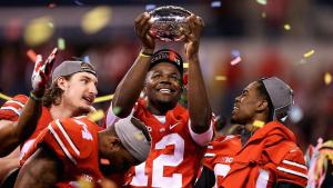 Cardale Jones holds up Big Ten Championship Trophy after Ohio State's 59-0 win over Wisconsin. (Getty Images)