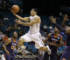 Oregon State's Malcolm Duvivier goes up for a shot against Auburn during the first half of an NCAA college basketball game Wednesday, Nov. 26, 2014, in Las Vegas. (AP Photo/John Locher)
