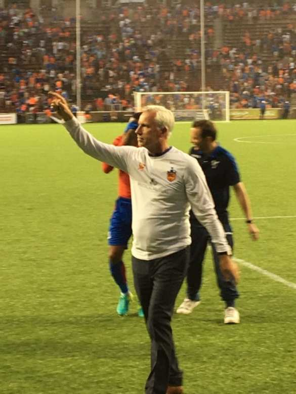 Crystal Palace manager Alan Pardew waves to the Palace supporters while wearing the custom FC Cincinnati shirt given to him after the match.