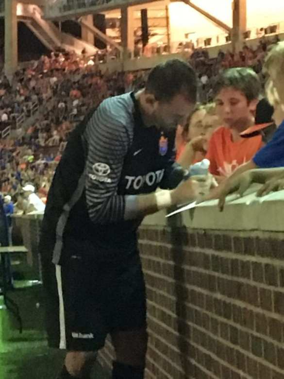 FC Cincinnati goalkeeper Dan Williams signing autographs after the match, which was his team debut.