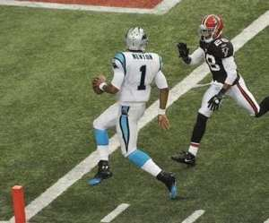 (Cam Newton beats Atlanta's Thomas DeCoud to the end zone (AP photo)