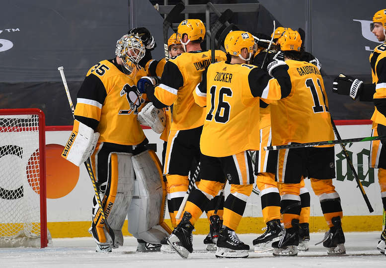 The Pittsburgh Penguins celebrate a game 2 victory over the Islanders