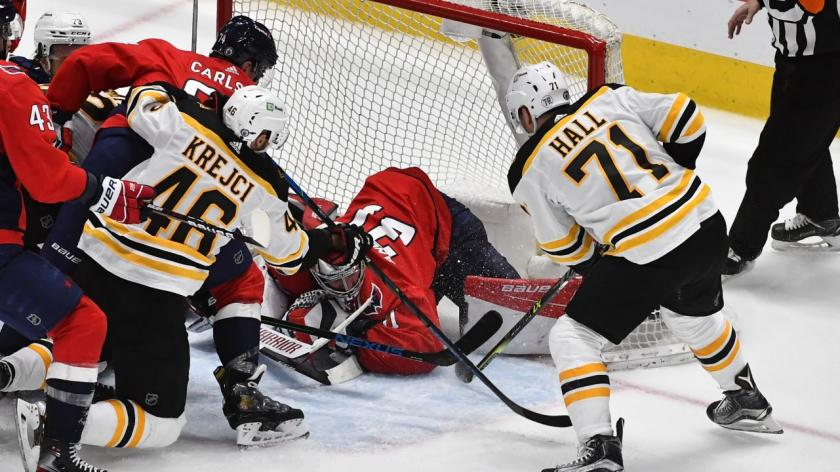 David Krejci and Taylor Hall crash the net in game 2 of round 1.