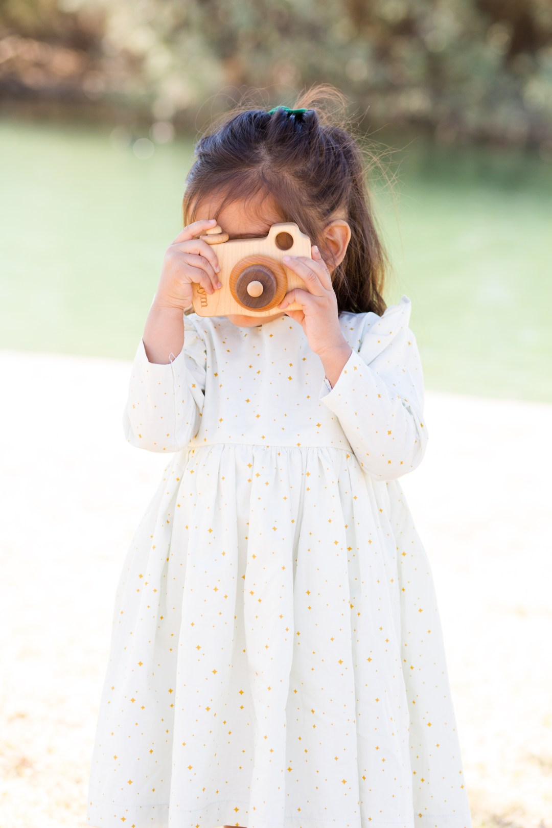 CuteHeads dresses, smiling tree toys wooden camera