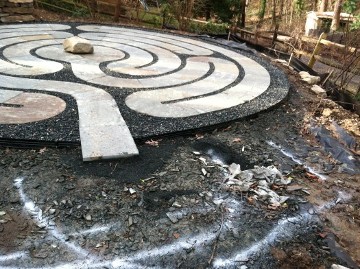 Gravel was placed in between the stones with a metal edging around the entire labyrinth. I marked where the Heart Space is to go.