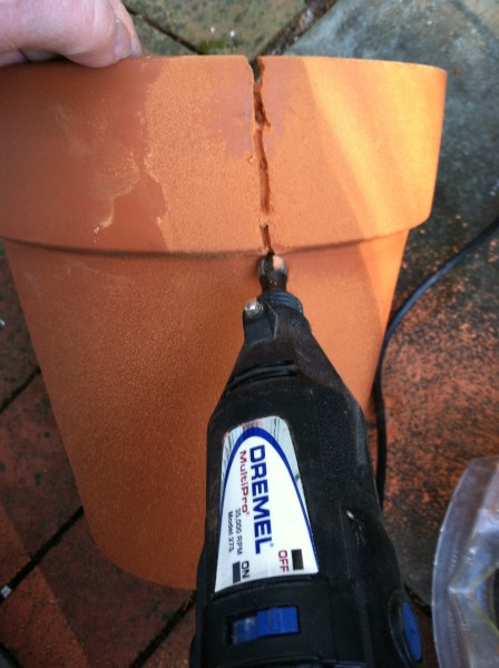 Cutting the terra cotta pot with a dremel and carbide tip