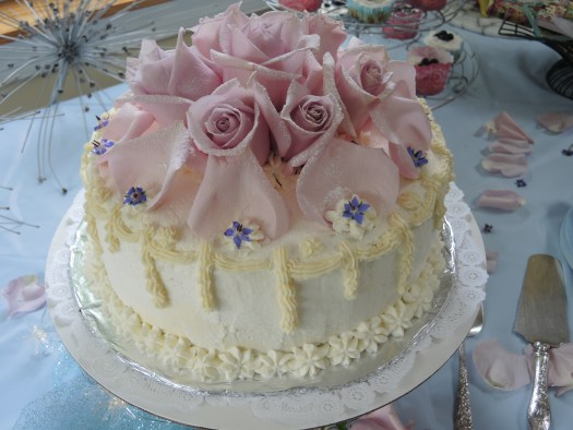Beautiful cake decorated with roses and borage blossoms, made by Maria Springer of http://www.majaskitchen.com/