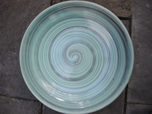 Pick a low wide bowl, even though this bowl has a beautiful pattern, you won't see it when the flowers are floating