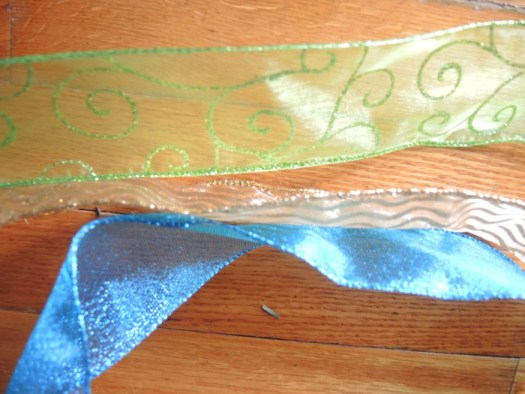 Arrange your ribbon in layers, and wire it together at 2 foot intervals; weave it through the garland