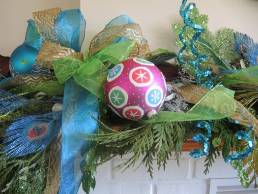 Make a large multi-lopped bow and weaves the ends into the garland and have some hang