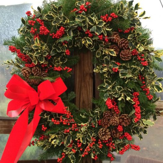 Red ribbon and berries make this wreath pop