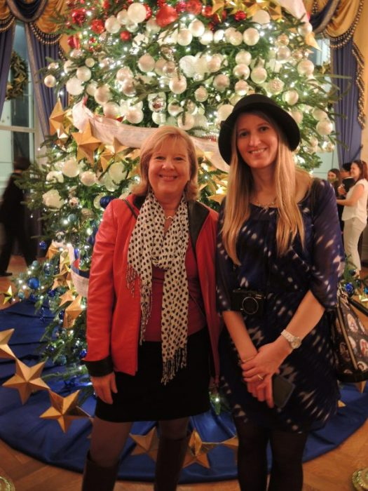 I am in front of the Blue Room tree with my daughter which took 3 days to decorate in 2015
