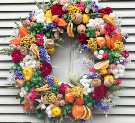 Holiday wreath made with dried flowers at Williamsburg
