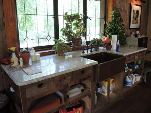 Just like a kitchen, combining a deep sink with counters is smart