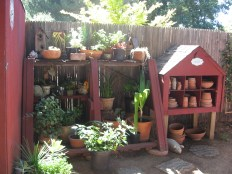 Vertical space used for storing pots and garden implements is attractive and inviting